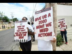 A group of 10 mothers from various communities in Central Kingston staged an anti-violence protest at the intersection of East Street and Beeston Street on Tuesday.