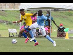 Harbour View's Oquassa Chong (left) getting away from Shawn Dewar of Waterhouse during a  Jamaica Premier League match on Monday, June 28.