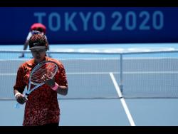 Naomi Osaka of Japan practises ahead of the 2020 Summer Olympics at Ariake Tennis Centre in Tokyo on Monday.