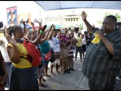 In this 2014 photo, Bishop Maurice Perrier, head of Fire Anointed Healing and Deliverance Ministries, preaches the gospel on the streets of downtown Kingston.