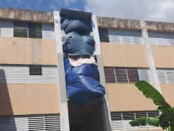Residents use tarp to cover sections of the scheme.