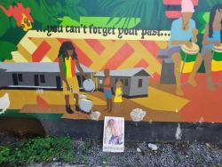 A mural of Georgie sharing out some of his popular dish is prominent in Culture Yard.