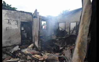 A Kingston family suffered a devastating blow after their house was razed in an early morning blaze yesterday.