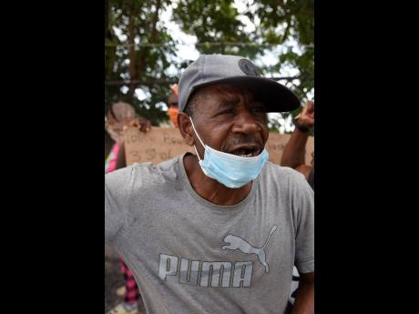 Sylton McLeod was distraught as he spoke about his daughter Tashekia during yesterday's protest.