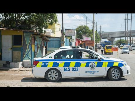 Police personnel outside the White Wing community in the St Andrew South Police Division.
