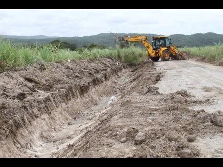 Drainage work being undertaken in St Jago, Toll Gate, Clarendon, where a mango agro-park is to be established.