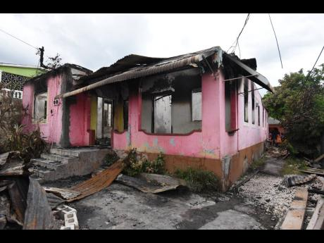 This 12-room house was razed in an early morning fire yesterday.